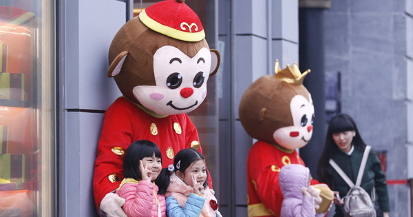 Promoting business by donning monkey costume