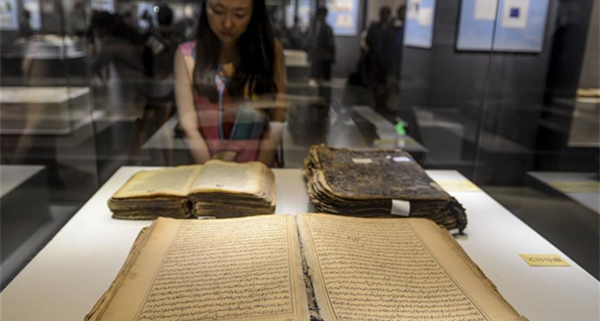Ancient books, documents of ethnic minorities in China displayed in Xinjiang