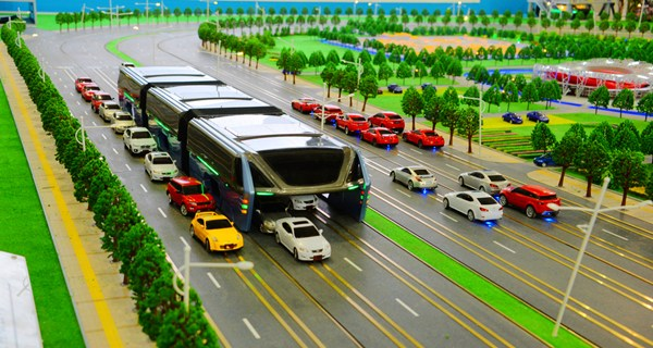 Futuristic straddling bus drives over cars