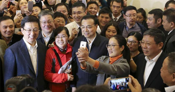 Li stresses reform, opening up during visit to Shanghai FTZ