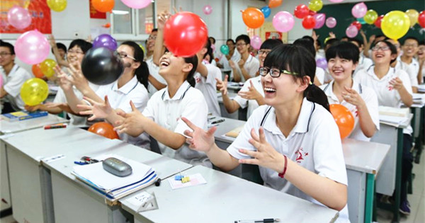 Balloons, paper planes and massages help students relax before college exam