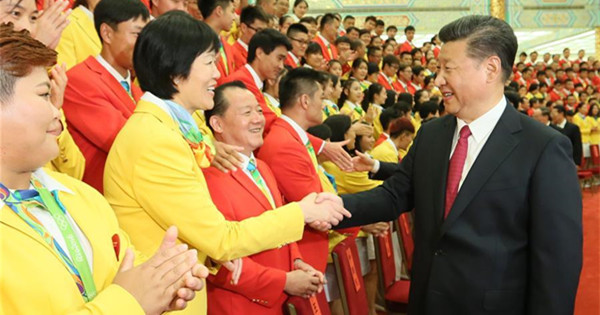 Chinese top leaders meet Olympic delegation