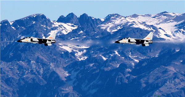 JH-7 fighter bombers in flight training