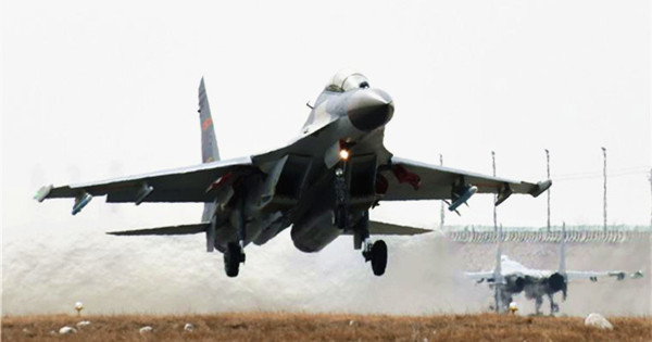 J-11 fighter jets fly under low temperature