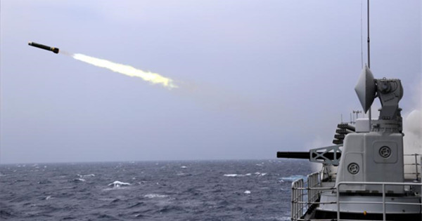 Destroyer fires main gun at night in South China Sea
