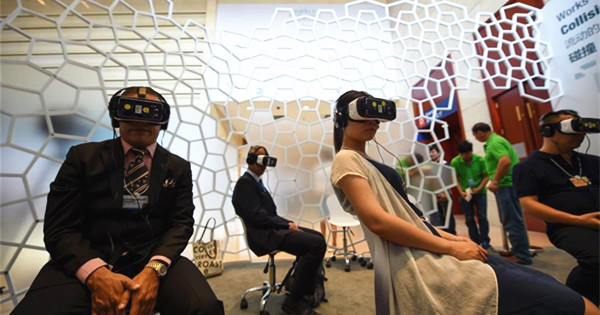 Visitors try at exploration zone on Summer Davos Forum in Tianjin