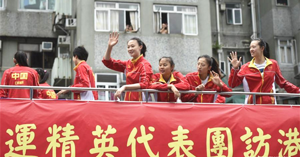 Mainland Olympians take part in float parade in HK