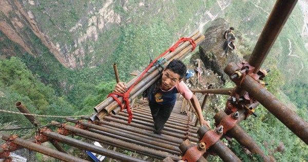 Village on cliff builds steel ladder to connect with valley 1km below