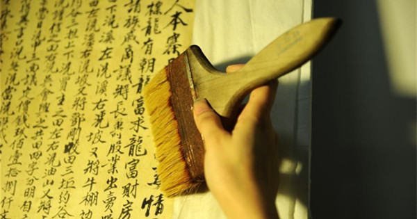 Young people join in preservation of ancient documents
