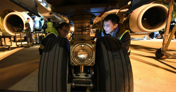 Mechanical engineers examine airplanes to ensure safety