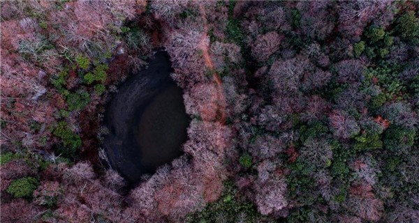 Gift from earth: Giant karst sinkholes found in NW China