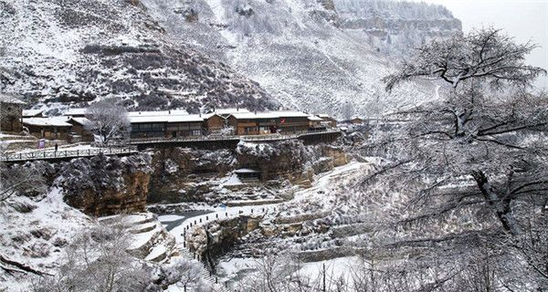 Hanging village on cliff after snow