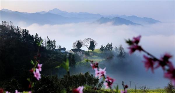 Clouds shroud ancient village Shitan, Anhui