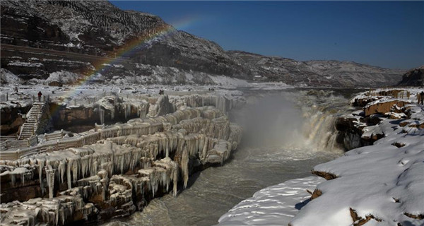 Icicles, rainbow seen at Hukou Waterfall
