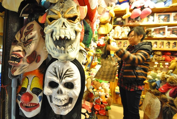 Masks, costumes and other Halloween-related merchandise are displayed at a store in Handan, Hebei province, on Wednesday, the day before the celebration. Halloween has become more popular in China, but some of its scarier masks and costumes cause concern that they may affect children negatively. He Qunying / For China Daily