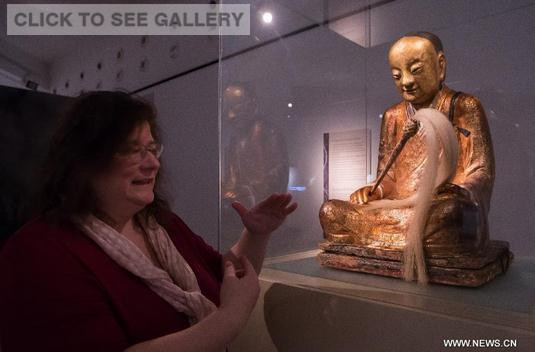 A Chinese Buddha statue with the mummified body of a Buddhist monk inside is on display at the Hungarian Natural History Museum in Budapest, Hungary on March 3, 2015. (Photo/Xinhua)