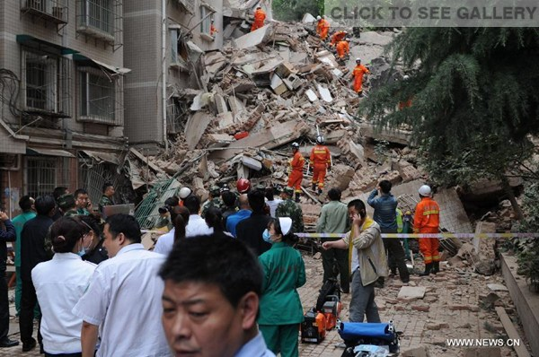 Rescuers search for survivors at a residential building collapse site in Guiyang, capital of southwest China's Guizhou Province, May 20, 2015. A nine-storey building collapsed in Guiyang on Wednesday. Rescuers have confirmed that there are people trapped inside, but casualties are not known yet. (Photo: Xinhua/Long Rui)