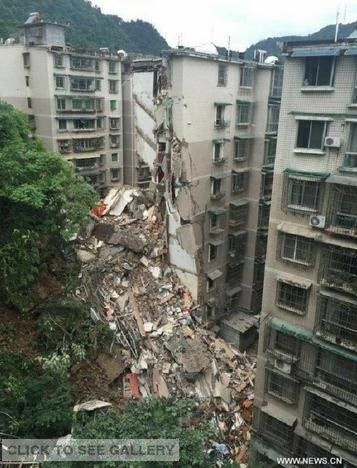 Rescuers search for survivors at a residential building collapse site in Guiyang, capital of southwest China's Guizhou Province, May 20, 2015. A nine-storey building collapsed in Guiyang on Wednesday. Rescuers have confirmed that there are people trapped inside, but casualties are not known yet. (Photo: Xinhua/Ou Dongqu)