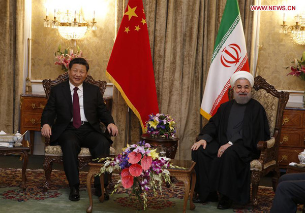 Xi meets with Iranian President Hassan Rouhani