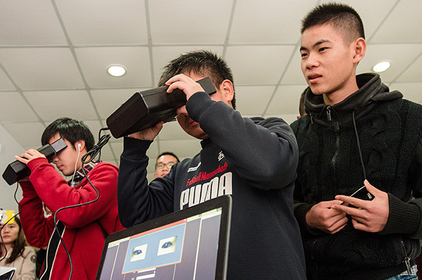 Students experience iris recognition developed by EyeSmart at Huazhong University of Science and Technology in Wuhan, Hubei province, earlier this month. CHINA DAILY