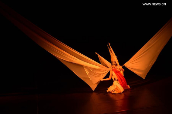 A dancer of the Beijing Modern Dance Company performs in