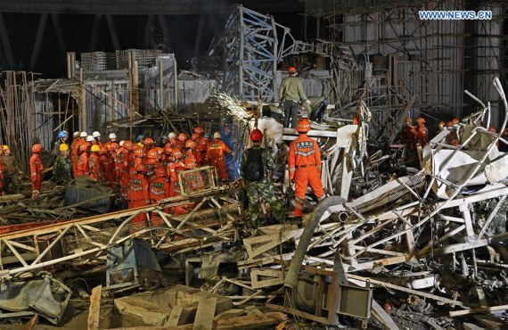 Rescuers work at the accident site at the Fengcheng power plant in Yichun City, east China's Jiangxi Province, Nov. 24, 2016.