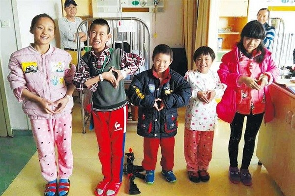 Five of the children who received free heart operations.(Courtesy of the children's hospital)