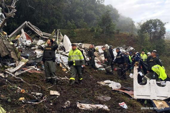 Image provided by Noticias Telemedellin shows rescuers inspecting the site of the crashed plane carrying the Brazilian soccer team Chapecoense, in La Ceja municipality, near Medellin, in the department of Antioquia, Colombia, on Nov. 29, 2016. (Xinhua/Noticias Telemedellin)