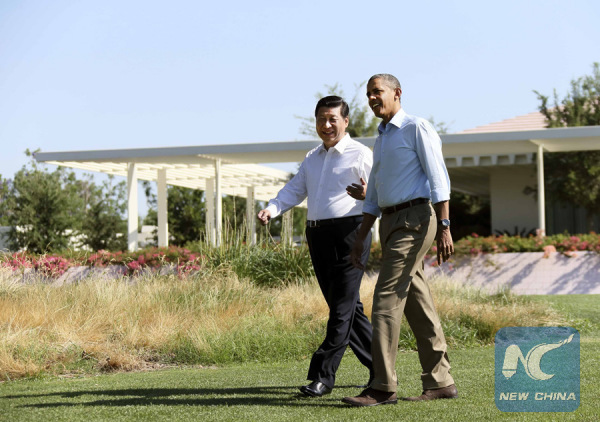 Chinese President Xi Jinping (L) and Barack Obama, then U.S. president, take a walk before heading into their second meeting, at the Annenberg Retreat in California of the U.S., June 8, 2013. (Xinhua/Lan Hongguang)