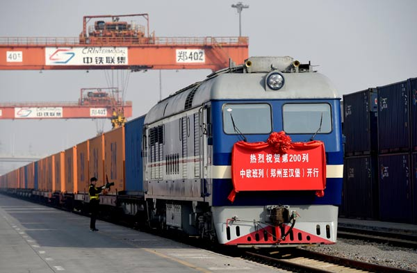 The 200th Zhengzhou-Hamburg cargo train pulls out of Zhengzhou railway station last September. (Photo by Xiao Jingsong/For China Daily)
