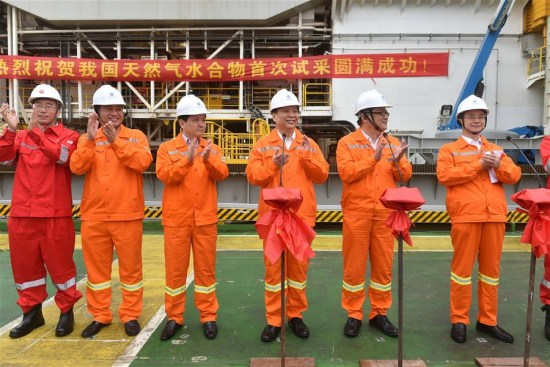 Chinese Minister of Land and Resources Jiang Daming (3rd R) announces the success in trial mining of combustible ice at sea, on a trial mining site in the Shenhu area of the South China Sea, May 18, 2017. (Xinhua/Liang Xu)