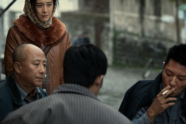 A smoking scene from the movie I Am Not Madame Bovary, which won the Dirty Ashtray Award this year. Provided To China Daily