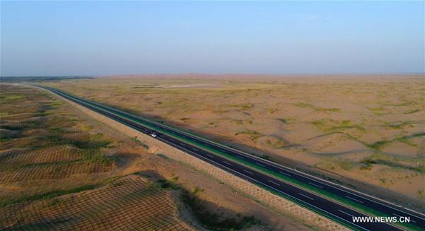Photo taken on July 14, 2017 shows the Jingxin Expressway (G7) in Bayan Nur City, north China's Inner Mongolia Autonomous Region. The Jingxin Expressway links Beijing, capital of China, and Urumqi, capital of northwest China's Xinjiang Uygur Autonomous Region. (Xinhua/Deng Hua)
