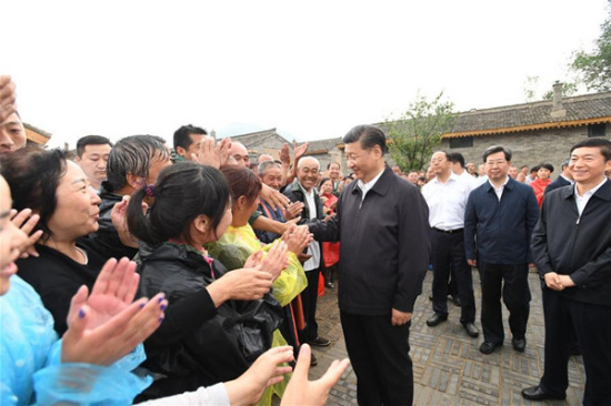 Chinese President Xi Jinping meets with local villagers at Songjiagou New Village, a centralized resettlement site under the approach of alleviating poverty through relocation, in Kelan County of Xinzhou City, north China's Shanxi Province, June 21, 2017. (Xinhua/Li Xueren)