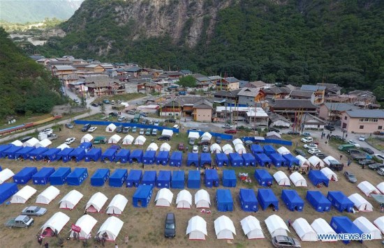 Photo taken on Aug. 11, 2017 shows tents at a temporary shelter in Zhangzha Village of Zhangzha Town in Jiuzhaigou County, southwest China's Sichuan Province, Aug. 11, 2017. (Xinhua/Xue Yubin)