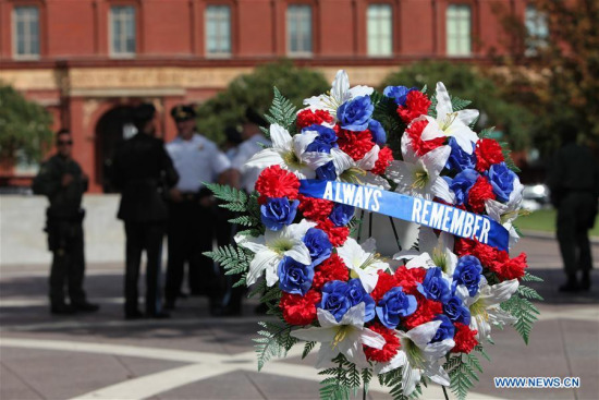 Law enforcement officers gather at the National Law Enforcement Officers Memorial to mark the 16th anniversary of the Sept. 11, 2001 terror attacks in Washington D.C., the United States, on Sept. 11, 2017. (Xinhua/Yang Chenglin)