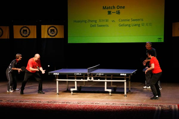 Former world champions Liang Geliang and Zheng Huaiying play with their American counterparts Dell Sweeris and Connie Sweeris, who visited Beijing in 1971, at the University of Michigan on Monday 45 years after the Chinese ping-pong delegation the U.S. in 1972. Zhang Ruinan/China Daily