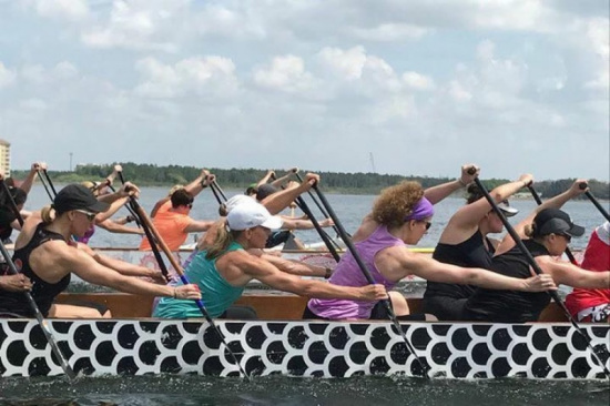 Participants in the  dragon boat during competition /Photo via Texas Dragon Boat Association