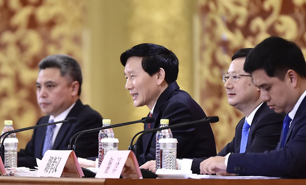 Spokesman for the 19th National Congress of the Communist Party of China Tuo Zhen (center) answers questions from journalists at a news conference at the Great Hall of the People on Tuesday in Beijing. (Photo/Xinhua)