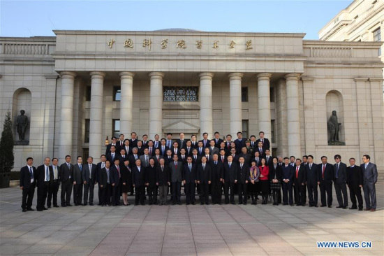 Newly-elected academicians of the Chinese Academy of Sciences (CAS) pose for a group photo in Beijing, capital of China, Nov. 28, 2017. CAS published the list of 77 newly-elected academicians, 61 Chinese and 16 foreigners, on its website Tuesday. There are now 800 Chinese academicians and 92 foreign academicians at CAS. (Xinhua/Jin Liwang)