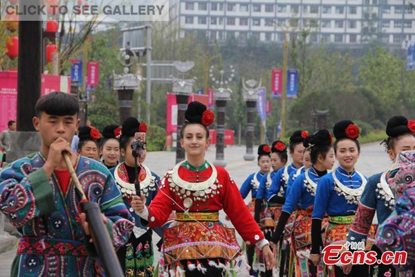 Jong May wearing a traditional Miao costume, welcomes visitors at the Wanda tourist resort in Danzhai county, Southwest China's Guizhou Province. Jong May was selected as cultural ambassador at the tourist resort under a promotion program starting in late June this year that invites people from across the world to serve on rotation basis. (Photo: China News Service/Wen Xinggui)