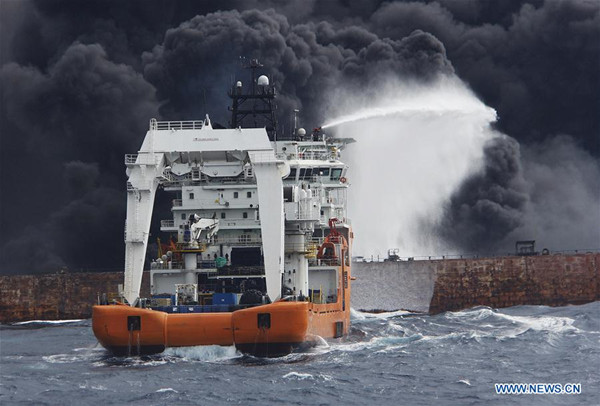 Rescuers spray foam to extinguish flames on the stricken oil tanker SANCHI off the coast of east China's Shanghai, Jan. 12, 2018. Shanghai Maritime Safety Administration said there is still a large fire on the Panama-registered oil tanker SANCHI. It is likely to explode and sink, the administration said at a press conference on Friday. (Xinhua)