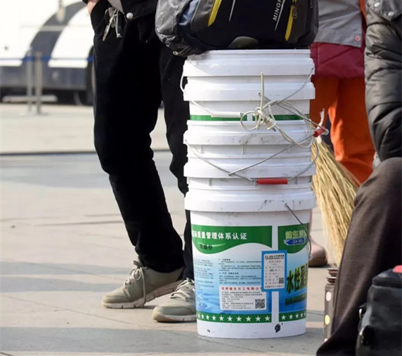 Plastic buckets better than luggage, say workers