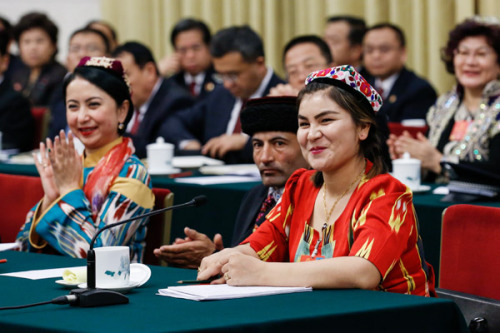 Ruqyam Masat, a deputy, addresses a plenary session of the Xinjiang delegation to the first session of the 13th National People's Congress in Beijing on Tuesday. (Photo by Kuang Linhua/China Daily)