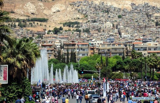 Syrians gather during a pro-government rally held at the Umayyad Square, in Damascus, Syria, on April 16, 2018. Thousands of Syrians in Damascus thronged the Umayyad Square celebrating the military victory in Eastern Ghouta despite the U.S.-led attack on Syrian military positions. (Xinhua/Ammar Safarjalani)
