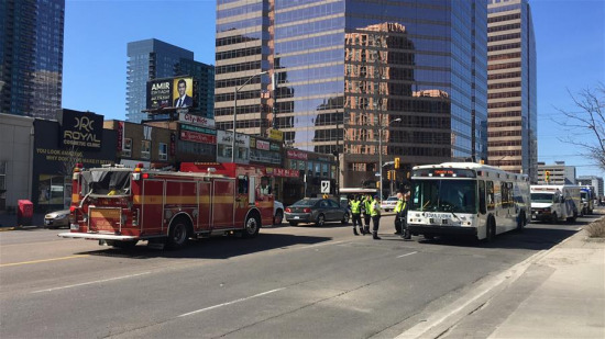 Emergency responders are seen near the site where a van struck pedestrians in Toronto, Canada, April 23, 2018. A white van struck multiple pedestrians in Toronto's northern suburbs on Monday and police have taken the driver into custody, police said on Twitter. (Xinhua/Zou Zheng)