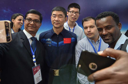 Astronaut Liu Boming attends the China Space Day celebration at the Harbin Institute of Technology on Tuesday in Harbin. Liu flew aboard the Shenzhou VII in 2008. (Su Dong/For China Daily)