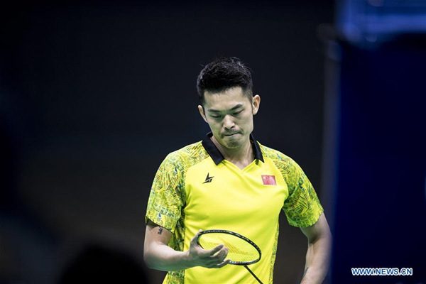 Lin Dan of China reacts during the men's singles first round match against Chinese Taipei's Wang Tzu Wei at Badminton Asia Championships 2018 in Wuhan, capital of central China's Hubei Province, April 25, 2018. Lin Dan lost by 1-2. (Xinhua/Xiao Yijiu)