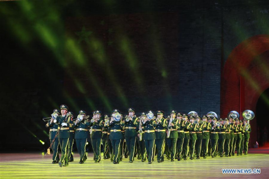 The military band of the Chinese People's Liberation Army (PLA) perform at the opening ceremony of a military band festival of the Shanghai Cooperation Organization (SCO) at a square of the Juyongguan Pass of the Great Wall in Beijing, capital of China, April 24, 2018. Military bands from eight countries, namely China, Kyrgyzstan, Pakistan, Russia, Tajikistan, Uzbekistan, India and Belarus, took part in the fifth SCO military band festival. (Xinhua/Ju Zhenhua)