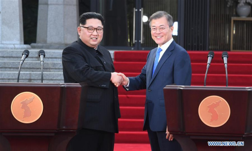 South Korean President Moon Jae-in (R) and Kim Jong Un, top leader of the Democratic People's Republic of Korea (DPRK) shake hands during a press conference at the border village of Panmunjom, on April 27, 2018. (Xinhua/Inter-Korean Summit Press Corps)